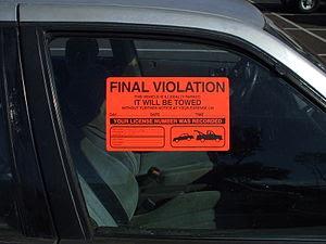 Closeup of parking violation sticker.