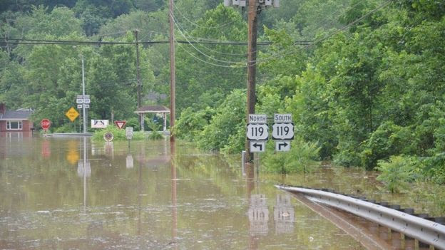 High water is seen after West Virginia was pummelled by up to 10 inches (0.2m) of rain, on 24 June