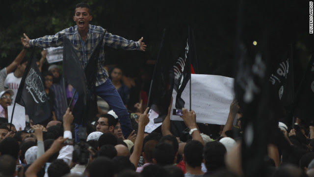 People shout slogans in front of the U.S. Embassy in Cairo.