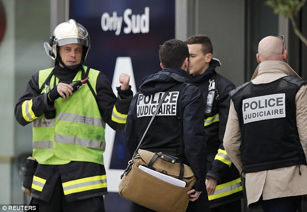 Judicial police investigators enter Orly airport southern terminal this morning