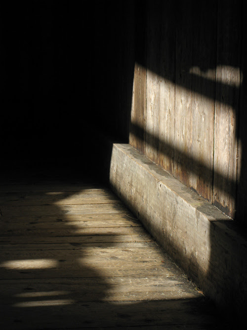 floor and wall boards in shadow, Chief Son-i-Hat Whale House, Kasaan, Alaska