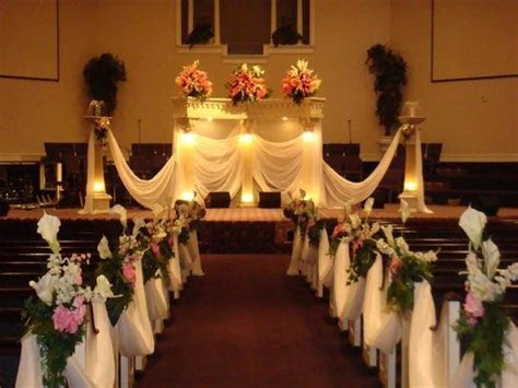 Pink and black table centerpieces, small church wedding