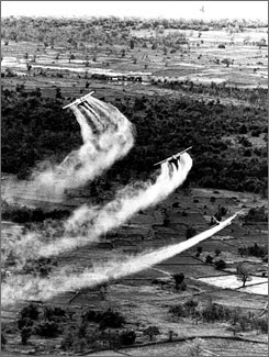 U.S. Air Force planes spray the defoliant chemical Agent Orange over dense vegetation in South Vietnam.