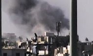 This image made from amateur video released by the Ugarit News and accessed Tuesday, July 31, 2012, purports to show black smoke rising from buildings in Aleppo, Syria. United Nations observers say fighter jets are firing on anti-government rebels in Aleppo. The airstrikes come after President Bashar Assad issued a rare statement today, urging his armed forces to step up the fight against the rebels. (AP Photo/Ugarit News via AP video) THE ASSOCIATED PRESS IS UNABLE TO INDEPENDENTLY VERIFY THE AUTHENTICITY, CONTENT, LOCATION OR DATE OF THIS HANDOUT PHOTO