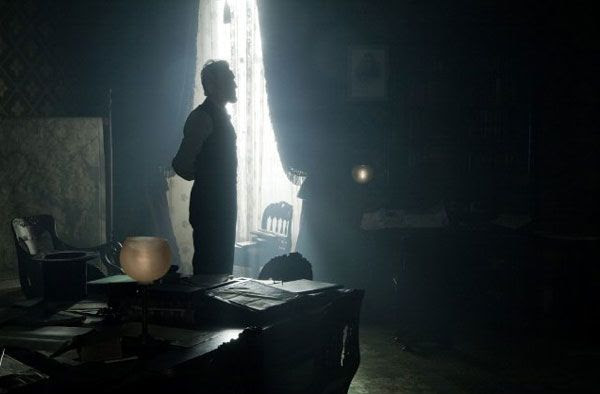 President Abraham Lincoln (Daniel Day-Lewis) has a moment of reflection in LINCOLN.
