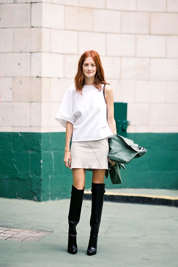 Le Fashion Blog -- London Street Style: Taylor Tomasi Hill -- Red Hair Asymmetric Top Skirt Over The Knee Boots -- Via Vanessa Jackman -- photo Le-Fashion-Blog-London-Street-Style-Taylor-Tomasi-Hill-Asymmetric-Top-Skirt-Over-The-Knee-Boots-Via-Vanessa-Jackman.jpg