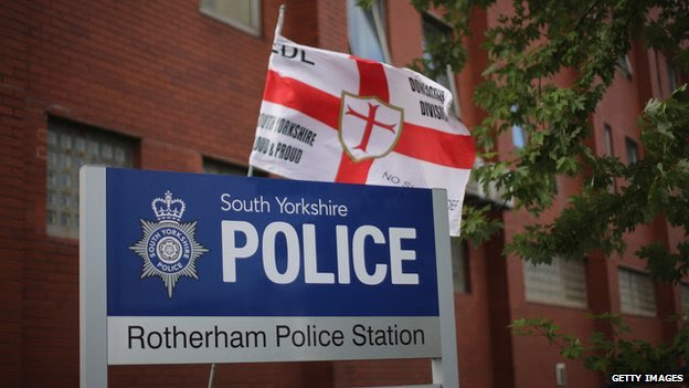 A new dawn? An EDL flag flies outside Rotherham Police Station
