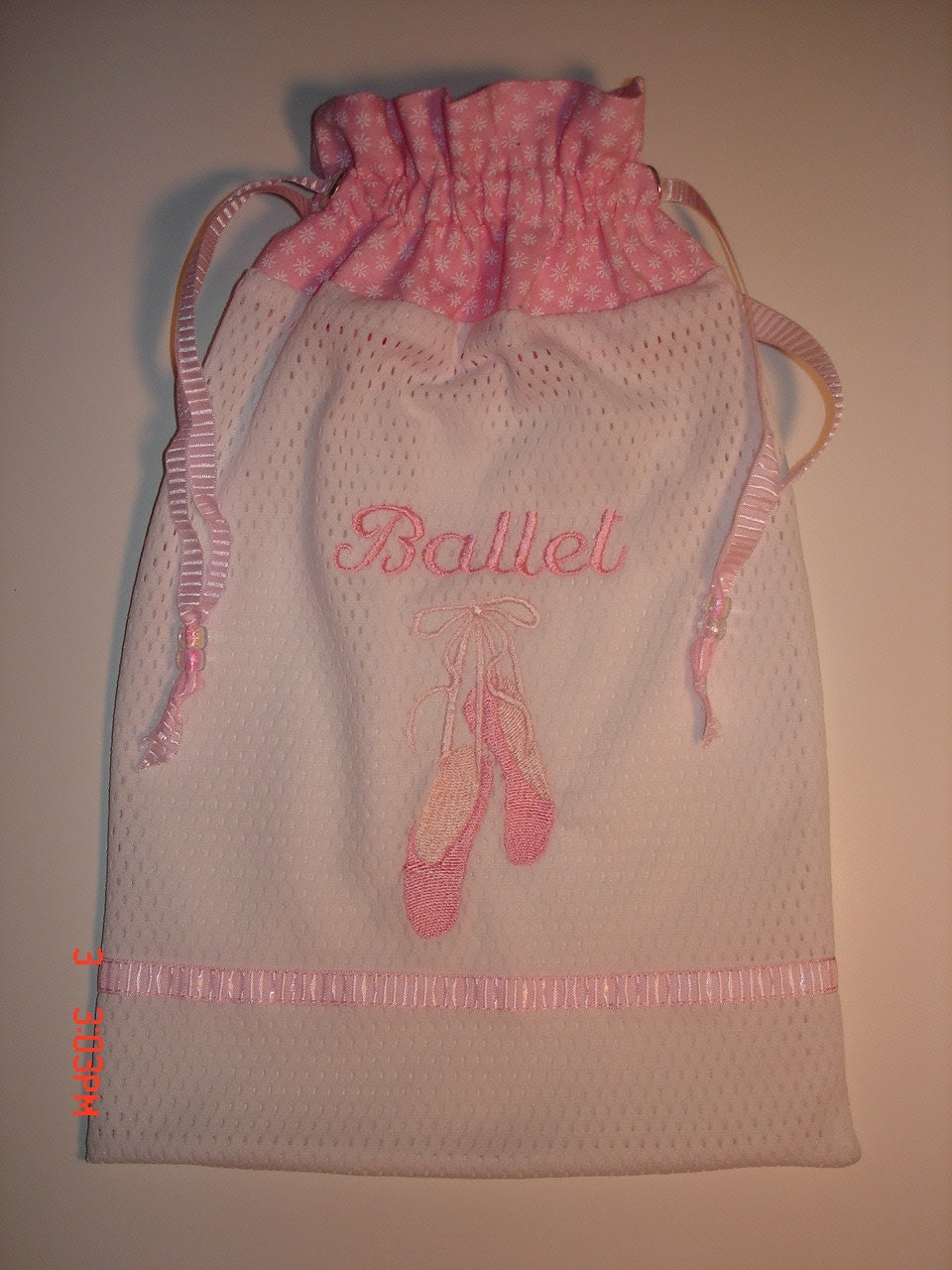 "Mesh pointe/ballet dance shoe bag with embroidered pointe shoes and the word ""Ballet"" also embroidered on the bag"
