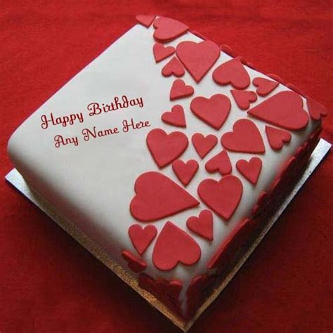 red heart shaped birthday cake with name