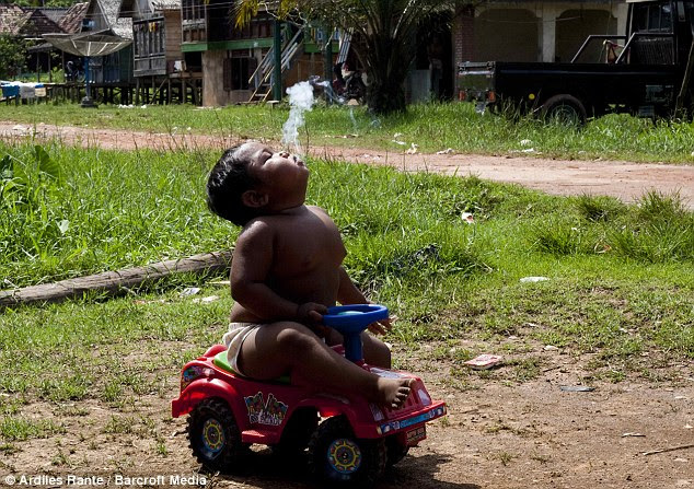 Puff baby: Ardi blows smoke while trundling around on his truck