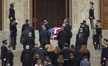 The casket containing the late Supreme Court Associate Justice Antonin Scalia, arrives for a funeral mass at the Basilica of the National Shrine of the Immaculate Conception in Washington, Saturday, Feb. 20, 2016. (AP Photo/Pablo Martinez Monsivais)