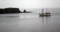 Fishing boat entering Kodiak harbor