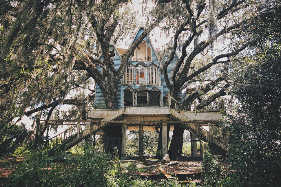 An abandoned child-sized Victorian-style tree house. [Florida]