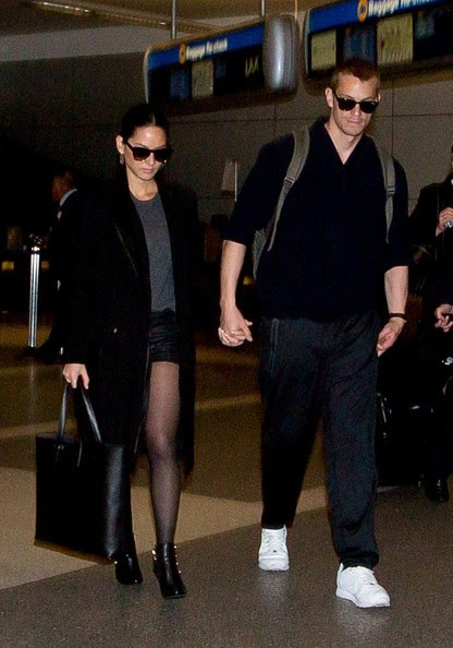 Olivia Munn and Joel Kinnaman are seen at LAX airport.