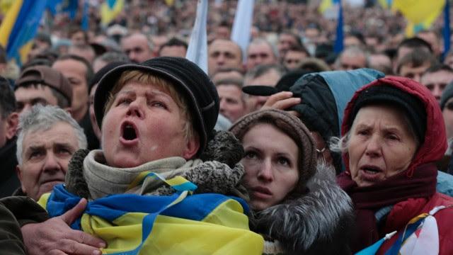 Pro-European Union activists shout slogans during the rally on December 8. An estimated 100,000 Ukrainians participated.