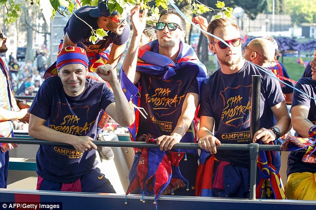 Andres Iniesta (from left to right), Sergio Busquets and  Ivan Rakitic pictured during the parade
