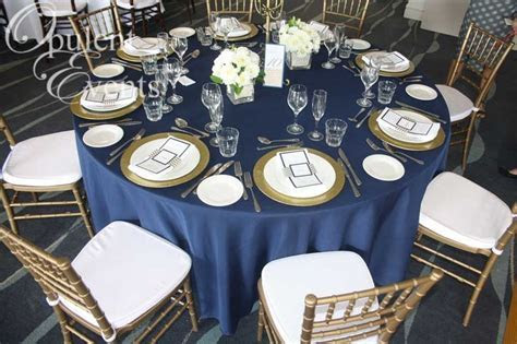 Gold and Navy Wedding: Gold Tiffany Chair, Navy linens