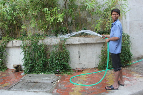 wasting water .. could be used in the slums by firoze shakir photographerno1