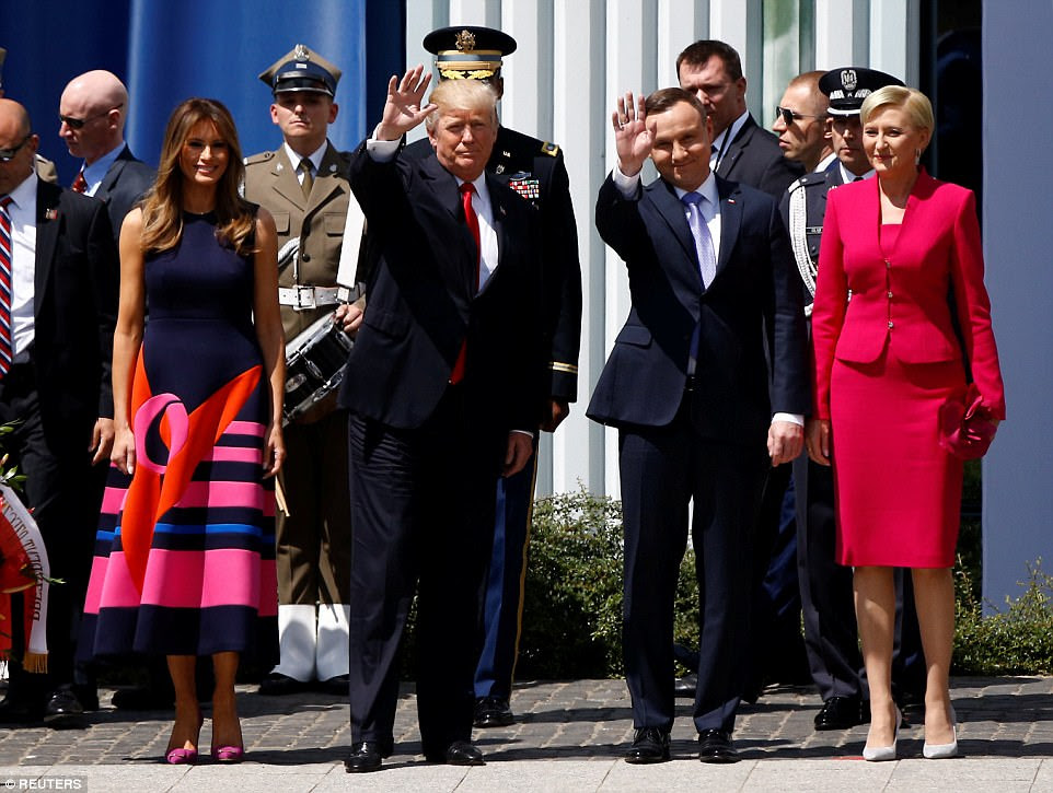 Trump waves next to First Lady of the United States Melania Trump, Polish President Andrzej Duda and First Lady of Poland Agata Kornhauser-Duda before his public speech