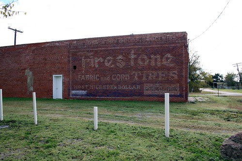 firestone ghost sign in lyons, texas