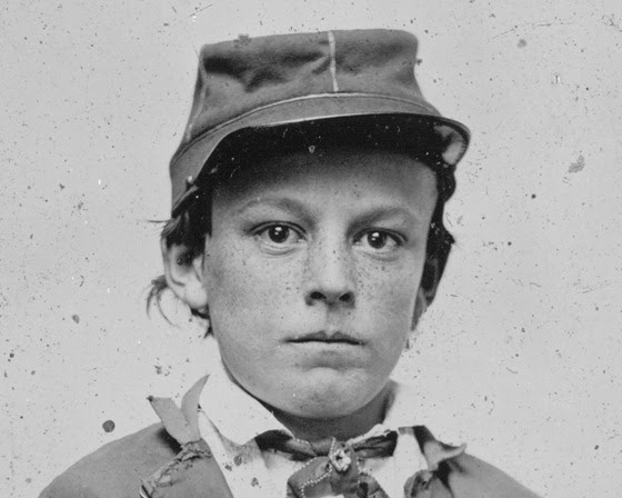 http://dotcw.com/wp-content/uploads/2012/08/Unidentified-young-soldier-in-Confederate-infantry-uniform-possibly-drummer-boy.jpg