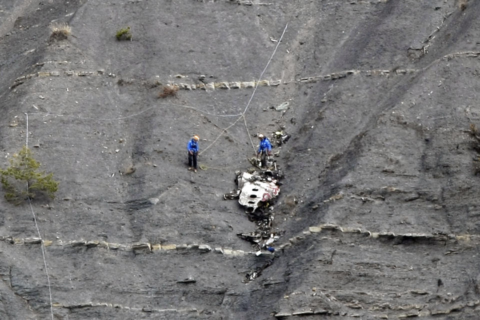 Rescue workers work at the crash site near Seyne-les-Alpes, France, Monday, March 30, 2015.  European investigators are focusing on the psychological ...