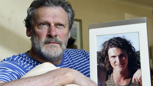 Bill McCormack with a photo of his son Shannon who died after being punched outside a cit