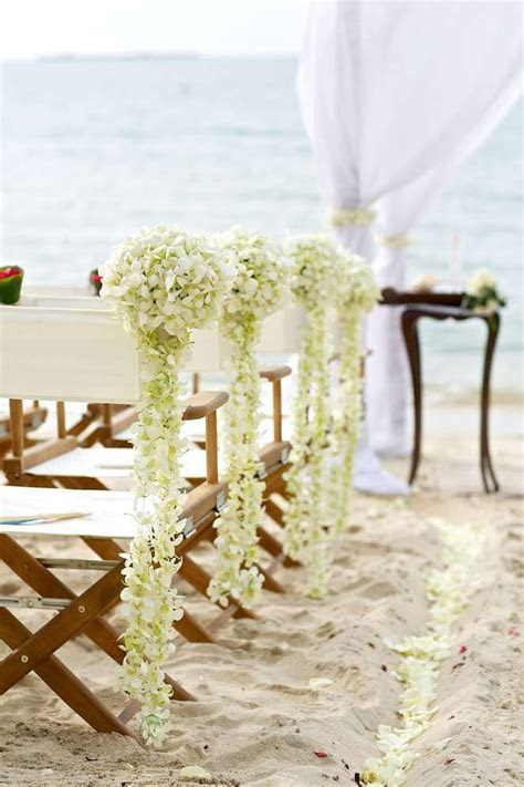 White orchid floral decoration and classic director chairs