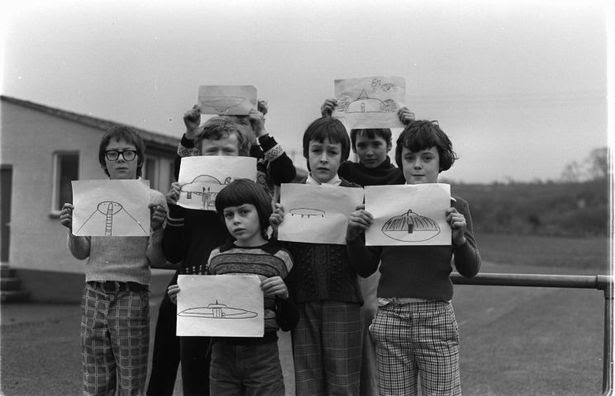 Broad Haven Primary pupils with their drawings of the spacecraft they witnessed in 1977