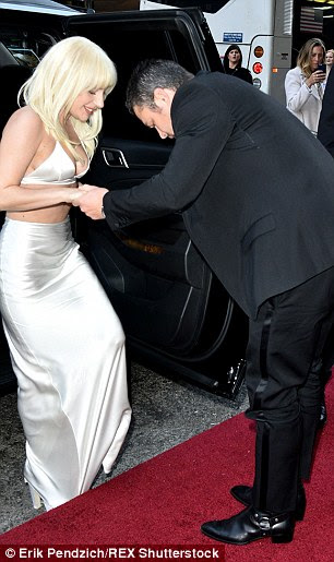 Charming: Taylor who couldn't keep his eyes off of his bride-to-be, proved to be the ultimate gentleman as gave her a helping up the steps