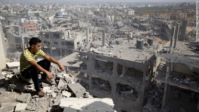 A Palestinian man looks out over destruction in the al-Tufah neighborhood of Gaza City, Gaza, on Wednesday, August 6, as a fragile 72-hour cease-fire between Israel and Hamas entered its second day. Israel launched a ground operation in Gaza on July 17 after a 10-day campaign of airstrikes had failed to halt relentless Hamas rocket fire on Israeli cities.