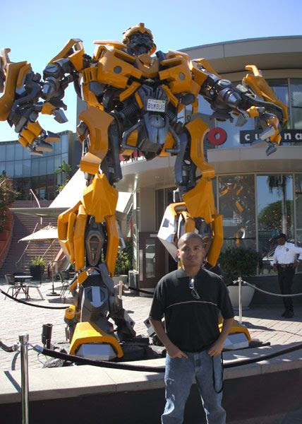 Posing in front of a life-size Bumblebee prop used in the film TRANSFORMERS...on October 19, 2007.