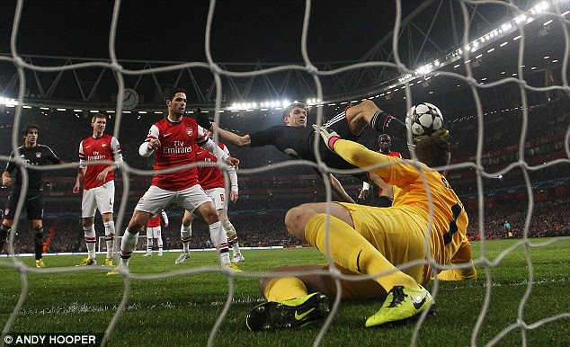 Back of the net: Germany forward Muller (floored) watches as his poked shot flies past Wojciech Szczesny
