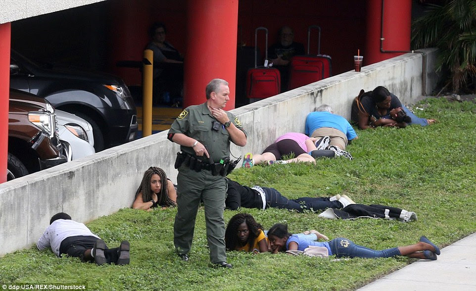 Police forced bystanders to take cover and lay low outside the Fort Lauderdale-Hollywood airport