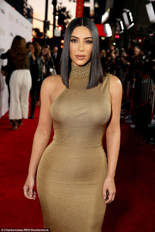 Gorgeous: The beautiful gold dress clung to her every curve