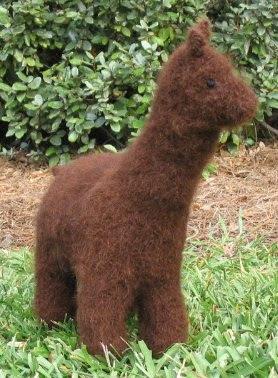 Handspun, handknitted, handfulled toy alpaca in alpaca fiber.