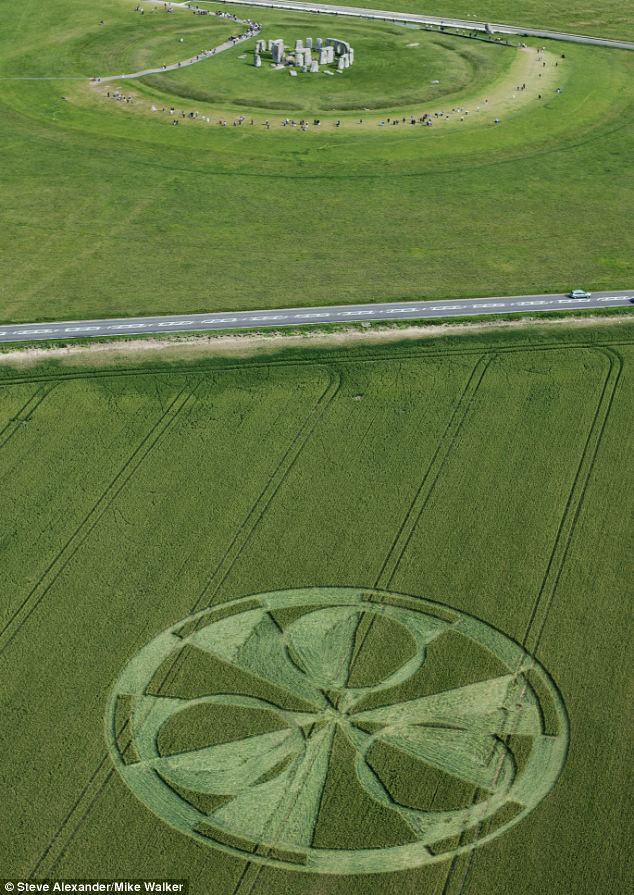 The huge 200ft diameter crop circle appeared in a field of wheat alongside Stonehenge