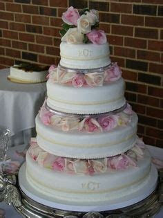 4 Tier Round Buttercream Wedding Cake with Pillars