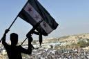 Defying dangers, Idlib residents protest Syria's Assad