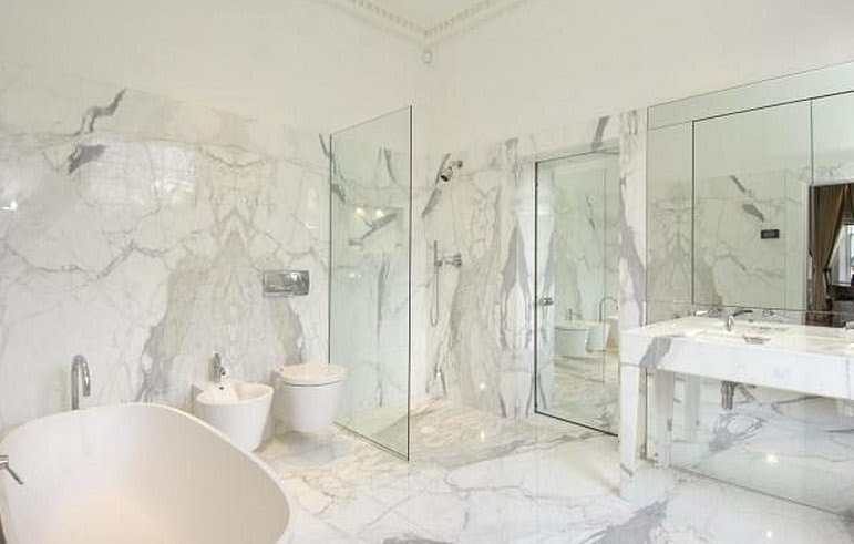 The master bathroom is covered in white marble, which will ...