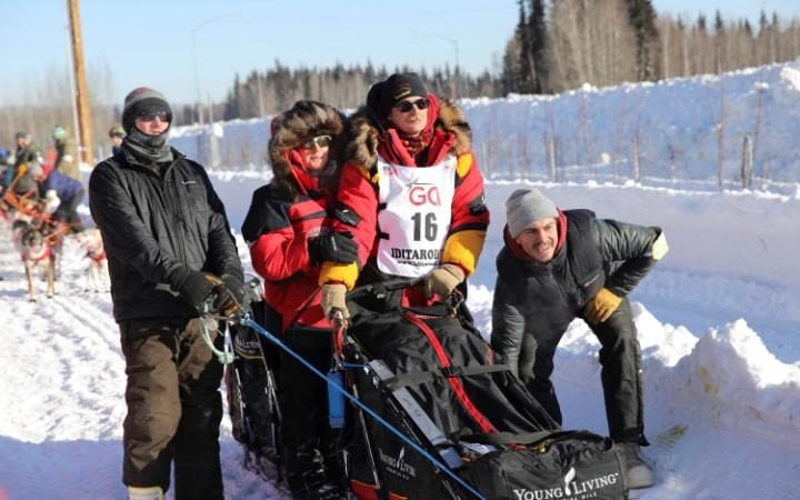 Two-times champion Mitch Seavey waits with his wife at the official restart gate of the Iditarod Trail Sled Dog Race.