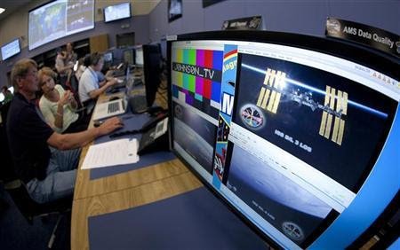The International Space Station (ISS) is pictured on a computer monitor at the Alpha Magnetic Spectrometer (AMS) Payload Operations and Command Center (POCC) at the European Organization for Nuclear Research (CERN) in Meyrin near Geneva July 25, 2012. REUTERS/Valentin Flauraud