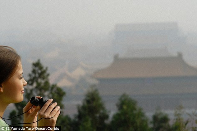 The tower will then travel around the world, from city to city, from Beijing to Paris and Los Angeles to Mexico City, if enough funds are raised. A stock image of a woman peering through the smog to see the Forbidden City in Beijing is shown