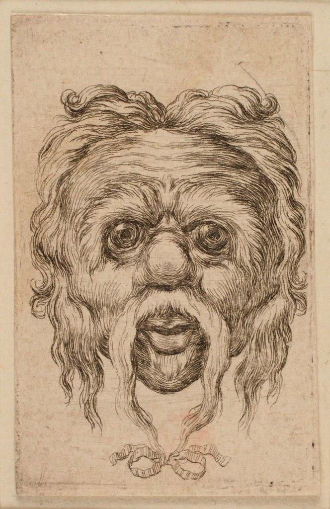Tête de singe à la moustache enrubannée