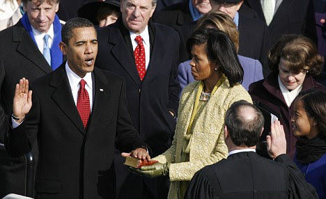 Flub: Barack Obama takes the oath given by Chief Justice John Roberts, Jr. (lower R) - but was it legitimate?