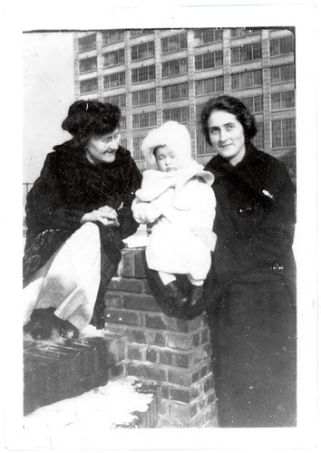 two women rooftop with baby