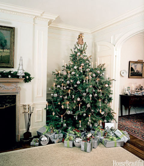 Real candles give the Christmas tree in artist Clare Potter's home an old-fashioned charm, but for safety reasons you should use lights at home; all-silver ornaments from Williams-Sonoma Home delight the eye.