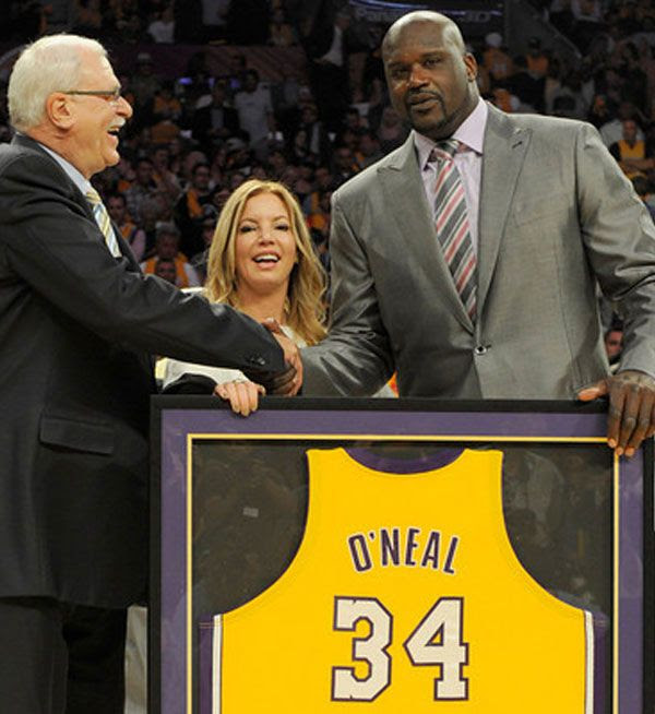 As Jeanie Buss looks on, former Lakers coach Phil Jackson congratulates Shaquille O'Neal during his jersey retirement ceremony at STAPLES Center in Los Angeles, on April 2, 2013.