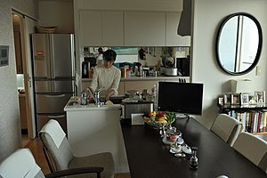 English: The dining room, kitchen, and a porti...