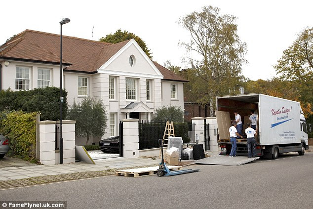 Removal men were pictured outside of Mesut Ozil's London home on Friday, appearing to move furniture